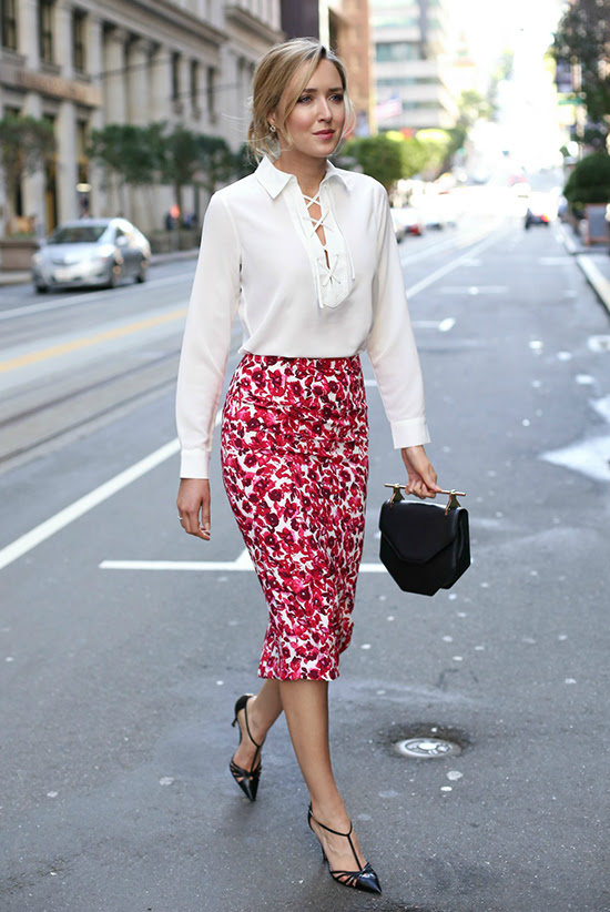 Street Style - The Top Blogger Looks Of The Week: Fashion blogger 'Memorandum' wearing a white lace-up blouse, a red floral print pencil skirt, black heels and a black handbag. Summer outfit, spring outfit, work outfit, night out outfit, street chic style.