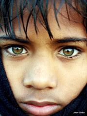 Green-eyed indian boy during Ardh Kumbh Mela |...
