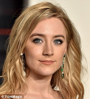 Long & dangly: Saoirse Ronan, 21, rocked a mismatched pair of Chopard earrings