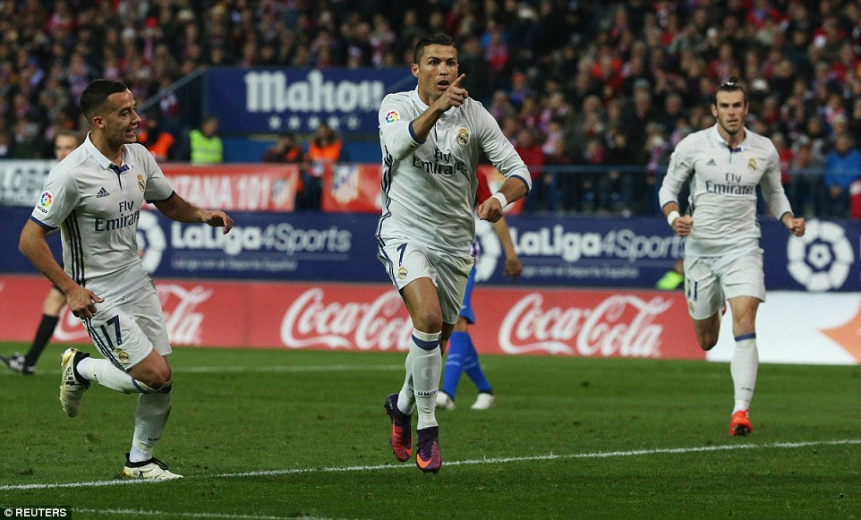 Ronaldo celebrates the second of his treble that put Real Madrid four points clear at the top of La Liga table