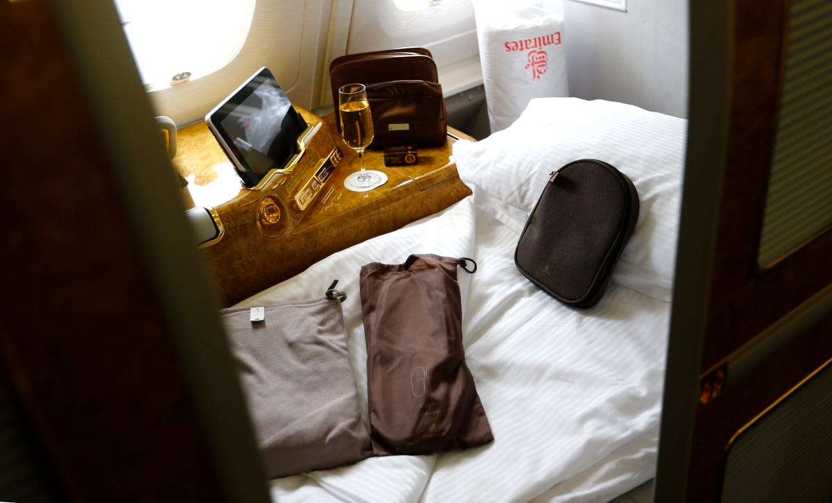 When boarding as a first-class passenger, you're greeted and escorted to your seat by a flight attendant and offered complimentary Champagne. You're given your own spacious cabin with sliding privacy doors and the kind of amenities that you'd expect to find in a high-end hotel. The leather seat reclines and becomes a bed.
