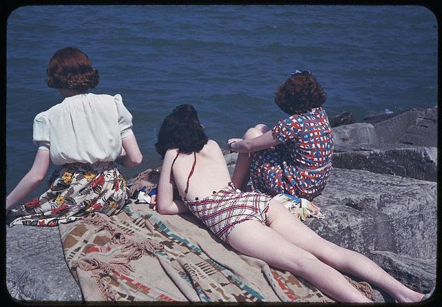 Two redheads and a brunette enjoy the refreshing breeze of the ocean on a sunny day in 1941. #vintage #beach #ocean #women #summer #1940s #hair
