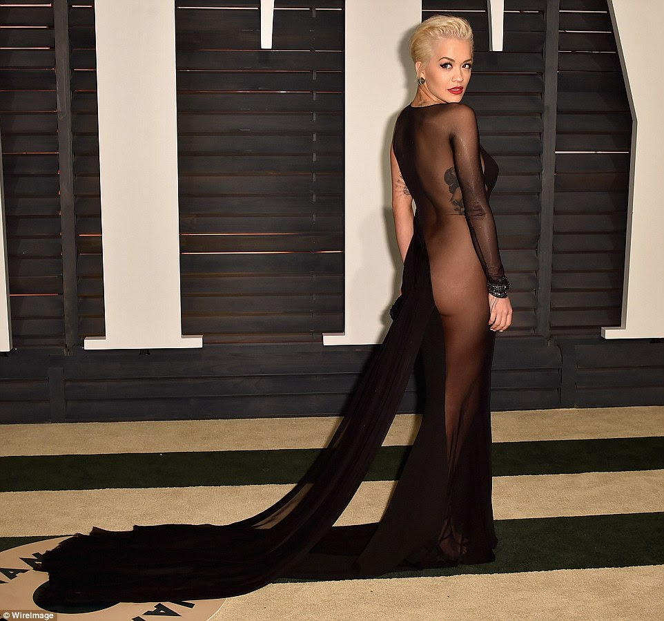 Barely there: Singer Rita Ora wows in a see-through black floor-length gown that left little to the imagination at the Vanity Fair Oscars party