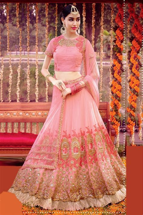 Net Semi Stitched Lehenga Choli In Baby Pink Colour   Lagn