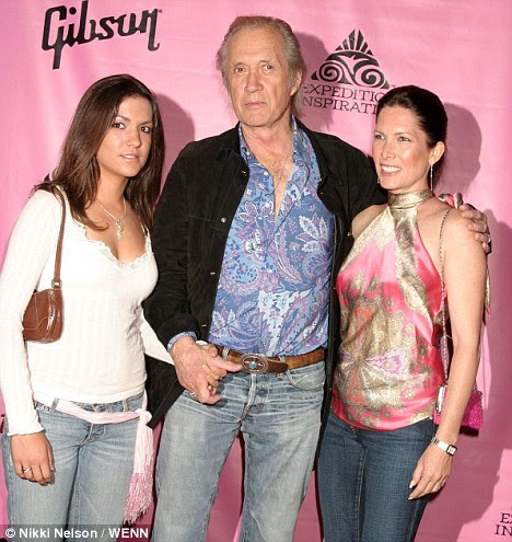Carradine with wife Annie, right, and daughter attending 'Rock the Cure' at the Hard Rock Cafe in Los Angeles in 2005