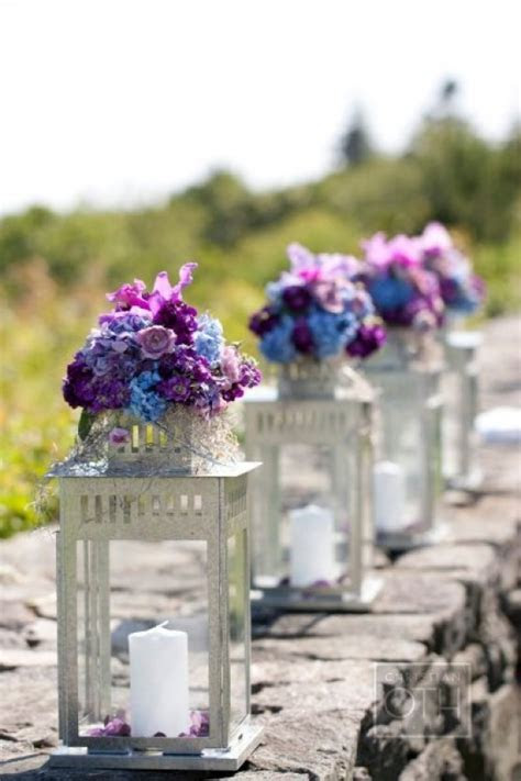 Candle lantern flower arrangements   FaveThing.com