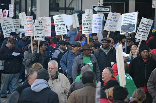 People took the streets in front of the federal courthouse in downtown Detroit during the first day of a bankruptcy trial.  by Pan-African News Wire File Photos