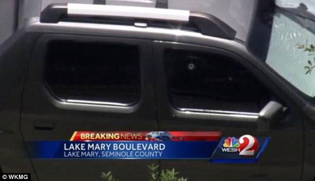 Shot: The bullet hole can be seen in the passenger window; Zimmerman suffered a minor gunshot wound