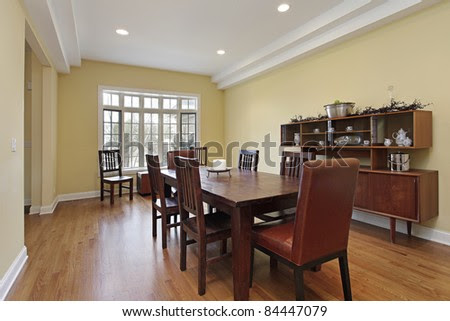 Dining Room With Tiered Ceiling And Wood Buffet Stock Photo ...