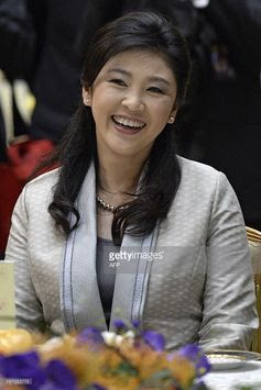 Thailand's Prime Minister Yingluck Shinawatra smiles before the start of lunch at the Association of Southeast Asian Nations (ASEAN) summit in Bandar Seri Begawan on April 25, 2013. Southeast Asian leaders of the 10-member grouping were set to wrap up a summit on April 25 dominated by efforts to defuse tensions over the South China Sea and deepen economic links throughout the region.       AFP PHOTO / PHILIPPE LOPEZ        (Photo credit should read PHILIPPE LOPEZ/AFP/Getty Images)