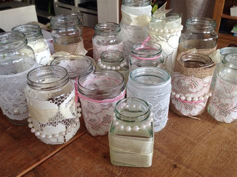 Lace and pearl wedding jam jars   wedding table decor