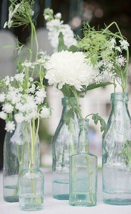 DIY Wedding Centerpiece..love the queen anne's lace.  I thought a wild flower bouquet would be awesome.
