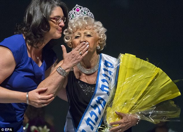 Joy: Ms Koka blows a kiss at the crowd as she is handed an award during the ceremony