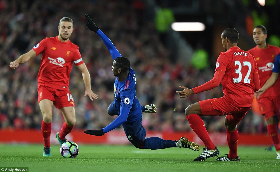 Paul Pogba was getting his first taste of the Liverpool-United derby and threw himself into it early against Jordan Henderson