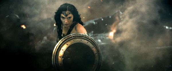 Wonder Woman deflects Doomsday's blast with her shield in BATMAN V SUPERMAN: DAWN OF JUSTICE.