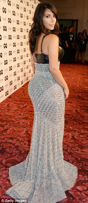 Standing out: Kim was the star attraction at the awards ceremony and proudly displayed her famous assets