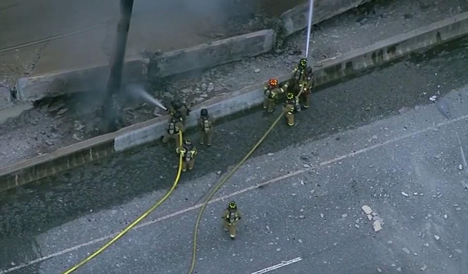 It is still not clear what was burning under the bridge or how the fire started. The Georgia Department of Transportation said inspectors are looking over the collapse, but there is no timeline on a fix. Firefighters are pictured extinguishing the fire