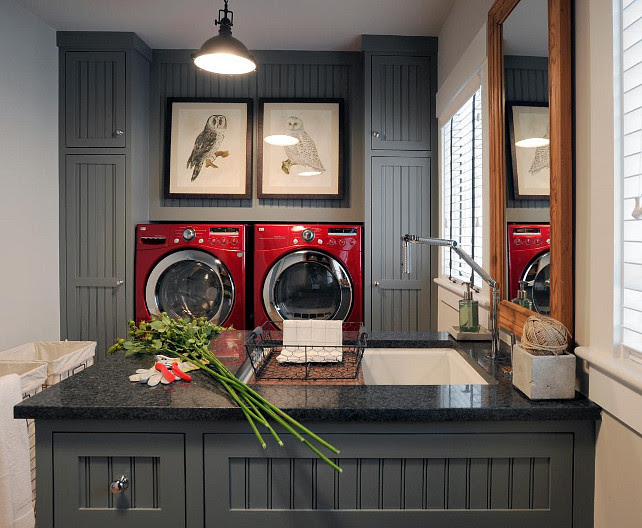 Laundry room. Charcoal laundry room cabinet paint color. Laundry room with charcoal gray cabinets and eco-friendly CaesarStone countertop. #LaundryRoom #CharcoalGray #Cabinet #Paintcolor #LaundryRoomIdeas  MacKenzie Brothers