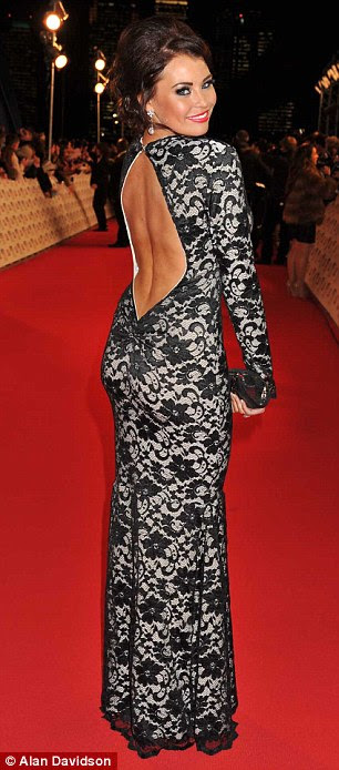 Essex glamour: Jessica Wright went for a Kate Middleton meets TOWIE dress in a full length backless lace gown, while Lauren Goodger wore a tight silver gown with a plunging neckline