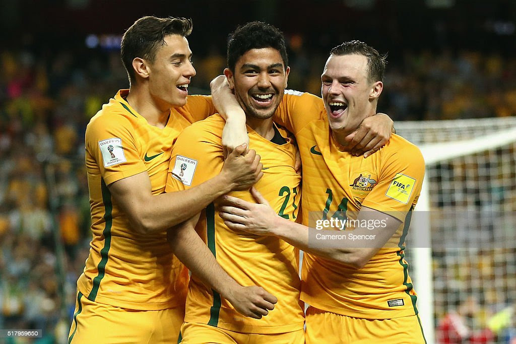 <a gi-track='captionPersonalityLinkClicked' href=/galleries/search?phrase=Massimo+Luongo&family=editorial&specificpeople=7995834 ng-click='$event.stopPropagation()'>Massimo Luongo</a> of Australia celebrates scoring a goal with Christopher Ikonomidis of Australia and <a gi-track='captionPersonalityLinkClicked' href=/galleries/search?phrase=Brad+Smith+-+Soccer+Player&family=editorial&specificpeople=14051296 ng-click='$event.stopPropagation()'>Brad Smith</a> of Australia during the 2018 FIFA World Cup Qualification match between the Australian Socceroos and Jordan at Allianz Stadium on March 29, 2016 in Sydney, Australia.