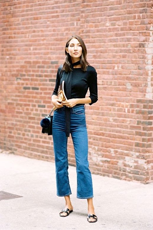 Le Fashion Blog Street Style Black Long Skinny Scarf Quarter Sleeve Tee Quilted Bag With Fur Pom Pom Keychain Kick Flare Denim Hermes Slide Sandals Via Vanessa Jackman