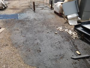 This photo shows an example of an Oil Spill and Contaminated Soil Identified During Phase 1 Environmental Inspection