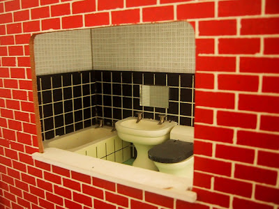 View of a vintage Lundby dolls' house bathroom through the window.
