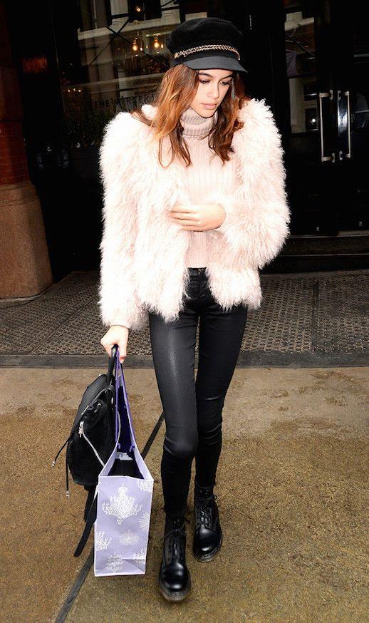 Le Fashion Blog Kaia Gerber Pink Fur Coat Pink Turtleneck Sweater Leather Leggings Black Combat Boots Via Who What Wear