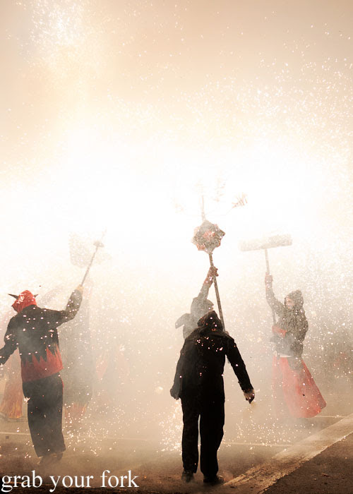 Diables devils spraying fireworks at Correfoc Fire Run for La Merce 2013