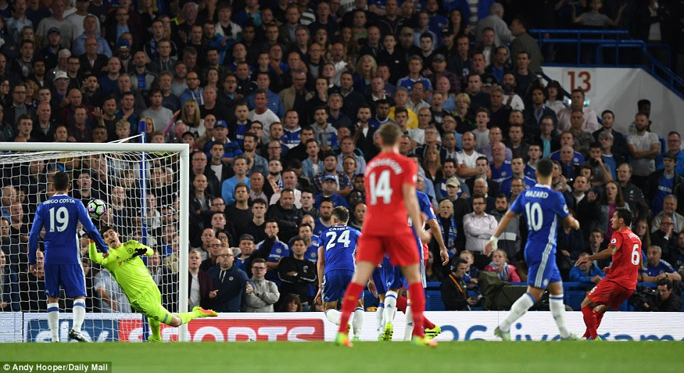 Chelsea keeper Thibaut Courtois dives in vain as Lovren's shot screams past him to hand Liverpool the lead