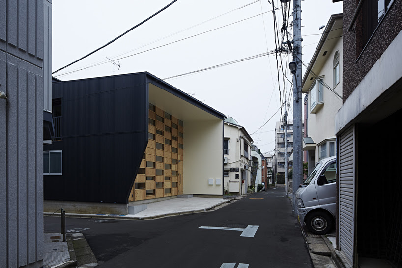 takeshi shikauchi's checkered house brings wood back to urban japan