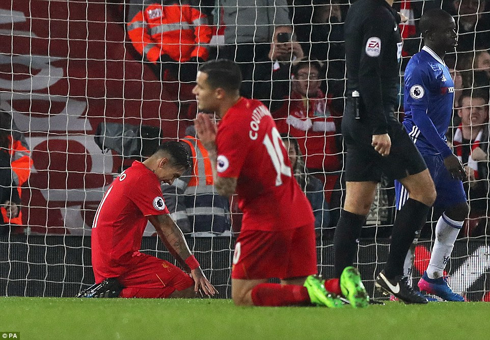Firmino reacts with disappointment after sending the ball into Row Z when Liverpool had a great opportunity to score
