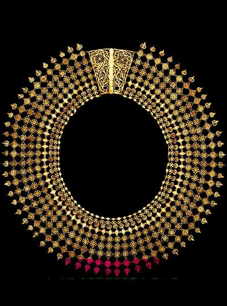 "This gold necklace was one of the earliest Indian objects bought for what would become the Victoria and Albert Museum. It was exhibited at the 1851 Great Exhibition as ""modern"" work from Calicut, and was bought for the considerable sum  for the new South Kensington Museum as an example of the best international contemporary design."