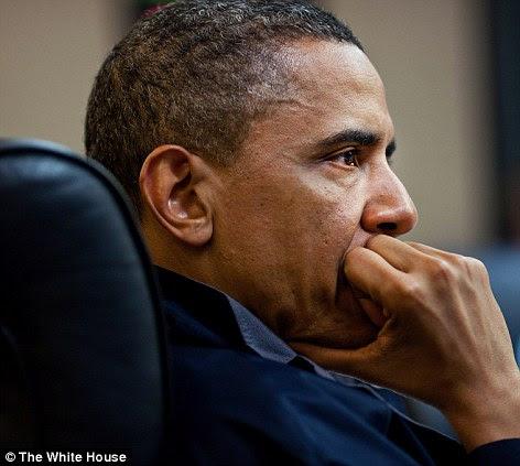 Tensão: O presidente Barack Obama parece preocupado que ele escuta durante uma de uma série de reuniões de discussão da missão contra Osama bin Laden