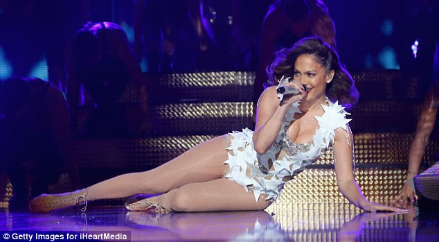 Leggy Lopez:Her luscious legs were on full display in some very fine fishnet stockings, and their length was emphasized further by a pair of high-heel, open toe lace-up booties