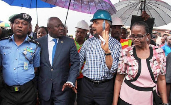 Governor Ambode flanked by the Permanent Secretary, Ministry of Special Duties, Mr. Aderemi Desalu and Commissioner for Police, Mr. Kayode Aderanti