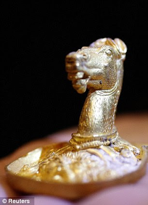 Intricate: History experts say the finds are likely to be remnants from the ritual burial of Gath ruler Kotela, one of the father-in-laws of Philip II of Macedon, the father of Alexander the Great. (Right) A golden horse head piece