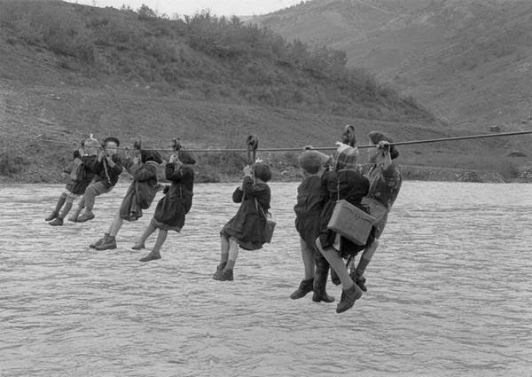 Captured From The Past : Children cross the river using pulleys