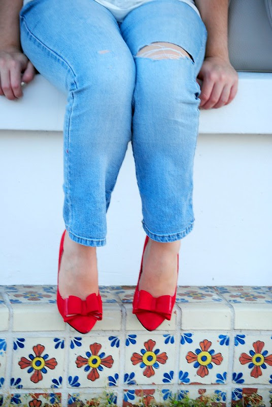 ripped jeans and bow heels