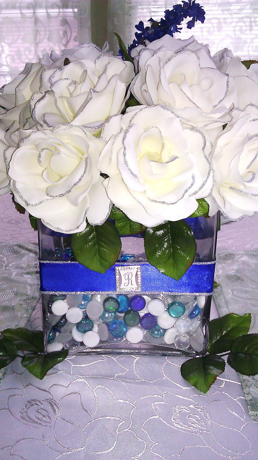 Custom Ivory Rose with Blue Ribbon and silver trimmings Glass Vase Centerpiece