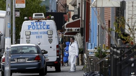 Crime scene personnel work at a crime scene in the Brooklyn section of New York, on 11 November 2013