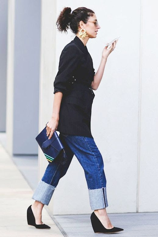 Le Fashion Blog Street Style Gold Statement Earrings Black Belted Jacket Blue Striped Clutch Cuffed Jeans Pointed Toe Wedges Via Refinery29