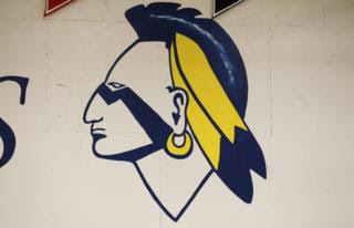 A Native American mascot painted on a wall