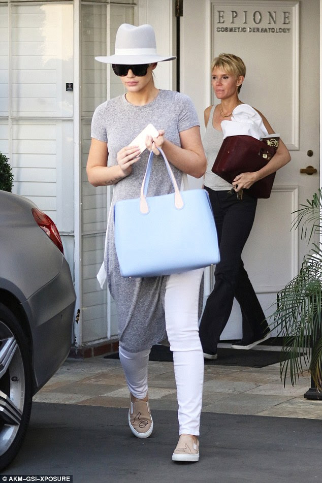 The bling's back: Iggy Azalea and her engagement ring ran very conspicuous errands around Beverly Hills, California on Friday