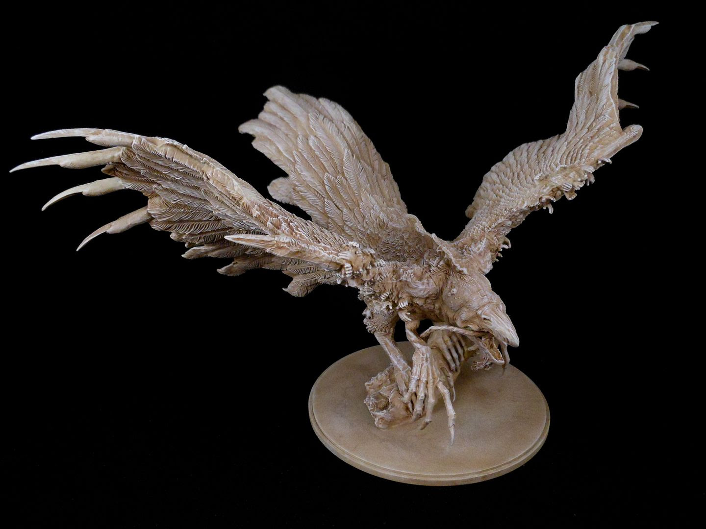 The phoenix from Kingdom Death: Monster, painted to look like a bone carving.