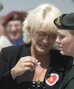 Wendy Hayward-Miskiewicz breaks down after leaving a rose on the casket of her son during his repatriation ceremony at CFB Trenton on Tuesday.