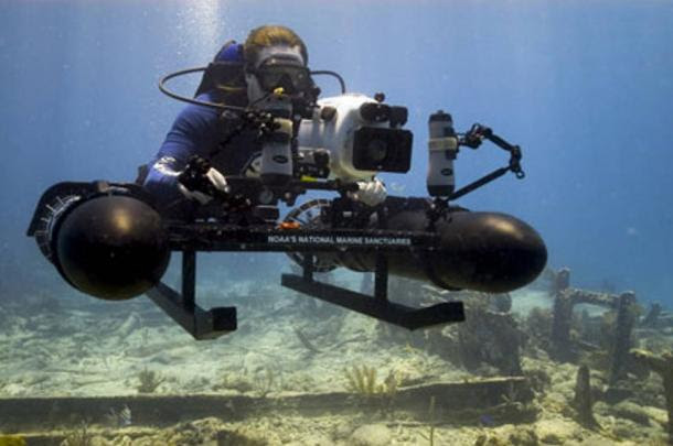 NOAA archaeologist does underwater research using specially a constructed sled mounted with a high-resolution camera.