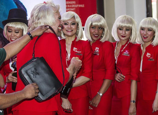 Here come the girls: Branson joined a number of other AirAsia stewardesses