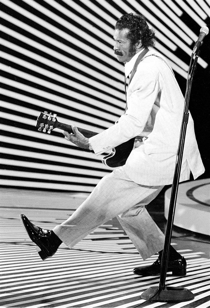 "In this April 4, 1980 file photo, guitarist and singer Chuck Berry performs his ""duck walk"" as he plays his guitar on stage. On Saturday, March 18, 2017, police in Missouri said Berry has died at the age of 90."