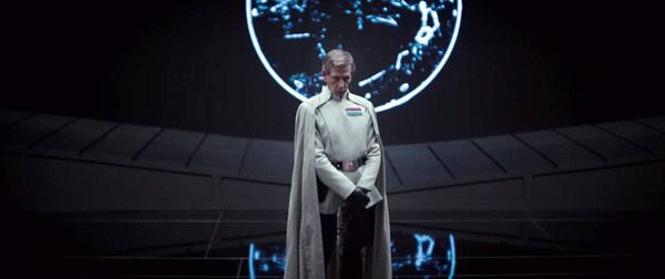 An Imperial security officer played by Ben Mendelsohn stands before a Death Star monitor in ROGUE ONE: A STAR WARS STORY.